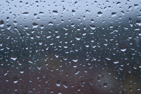 background of raindrops on glass photo
