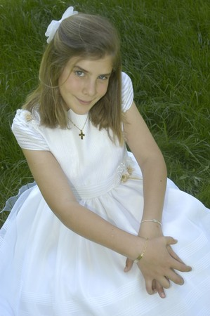 girl on the day of his first communion photo