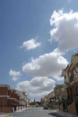 Private with blue sky and white clouds photo