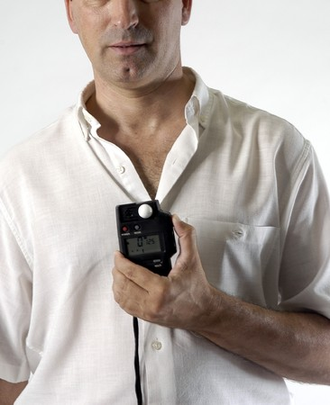 photographer with a photometer Stock Photo