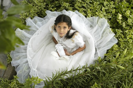 girl dressed in her first communion photo