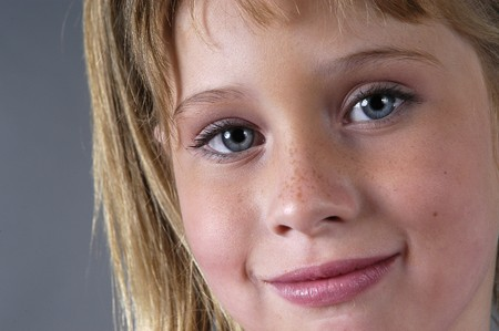 between 5 and 10 years: Blond girl with blue eyes Stock Photo