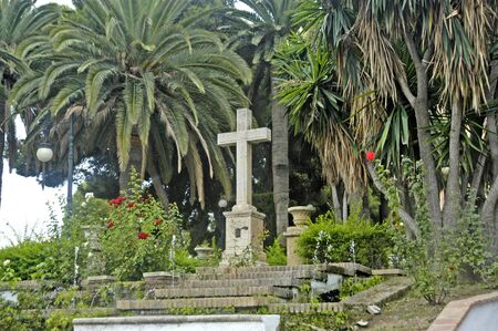 motril: stone cross in the park of the peoples of America from Motril, Granada Province