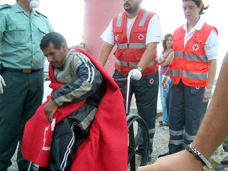 immigrants: 10102009 - Motril-Granada-Spain-Patera of illegal immigrants at the port of Motril