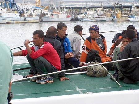 unlawful: 10102009 - Motril-Granada-Spain-Patera of illegal immigrants at the port of Motril