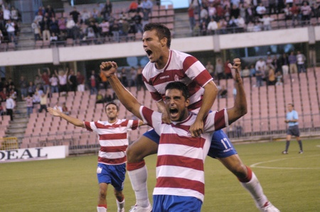 soccer match between fc granada and san roque de lepe martn ortega pictured is cast on the shoulders of tariq