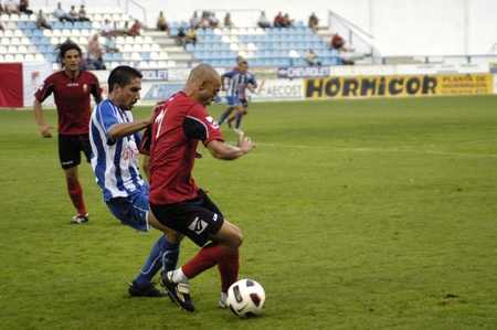 umpiring: preseason game between granada and motril cf motril cf 10242010 Editorial