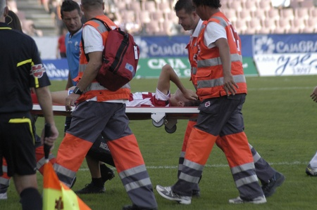 football match between the second division granada cf and ponferradina siqueira is off on a stretcher by the cross roj 09192010