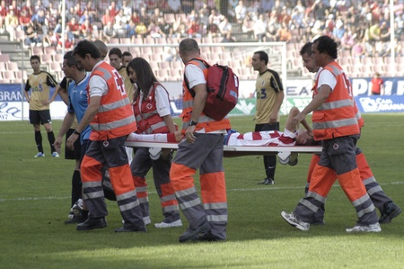 roj: football match between the second division granada cf and ponferradina siqueira is off on a stretcher by the cross roj 09192010