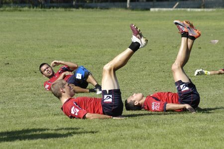 stretching and warming of granada cf footballers 05/12/2010 Stock Photo - 9690776