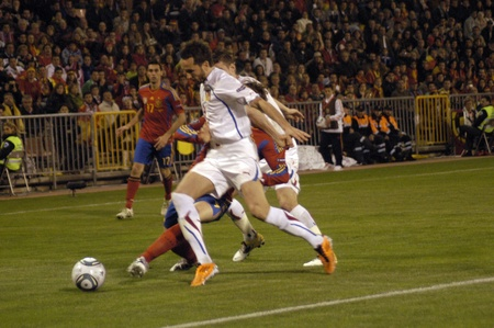 impartiality: international football match between the spanish team in football and the czech republic in the stadium crmenes of granada 25032011 Editorial