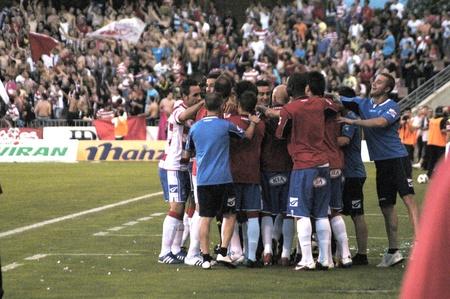 warning fans: football match between granada and elche cf 2 celebracipn the goal of granada 05292011 Editorial