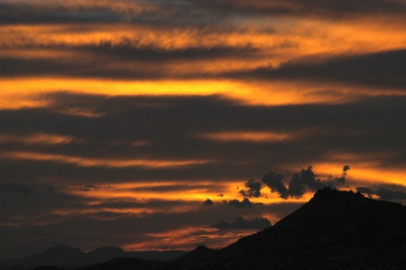 incommunicado: global warming and sunset in sierra elvira, granada in the province of