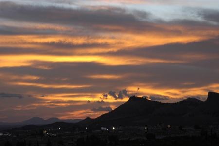 incommunicado: global warming and sunset in sierra elvira, granada  Stock Photo