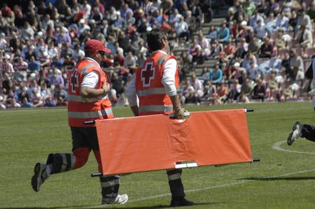 philanthropist: volunteers of the spanish red cross in a granada football game Editorial