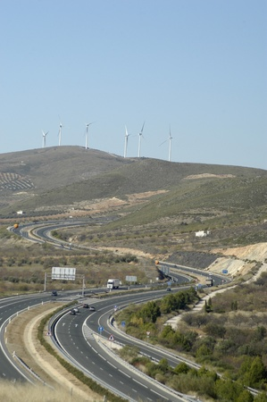 motril motorway to dance its way through durcal with wind turbines in the background. 26/11/2011 Stock Photo - 11336199