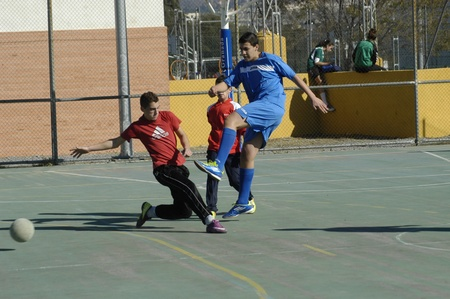 junior soccer: children playing football in a sports hall of Granada. 26-11-2011