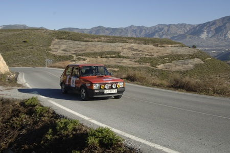 rally of classic cars of the first snow of the Sierra Nevada, between Shell and Saleres stretch. 26/11/2011 Stock Photo - 11336221