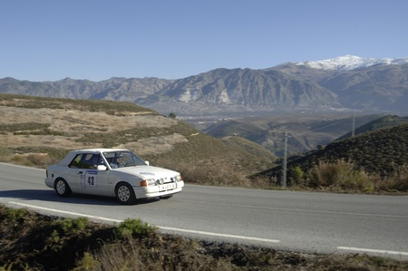 rally of classic cars of the first snow of the Sierra Nevada, between Shell and Saleres stretch. 26/11/2011 Stock Photo - 11336215