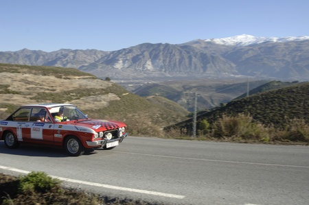 rally of classic cars of the first snow of the Sierra Nevada, between Shell and Saleres stretch. 26/11/2011 Stock Photo - 11336218