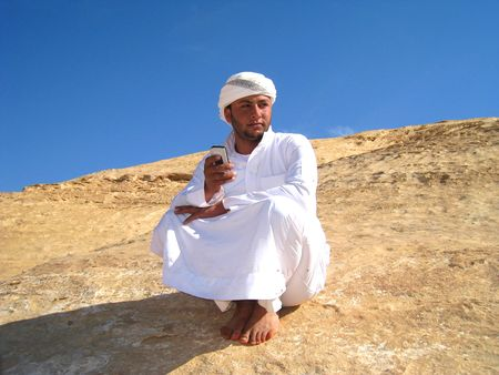 modernization: Bedouin talking by phone