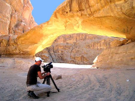 Cameraman filming in Wadi Rum desert Editorial