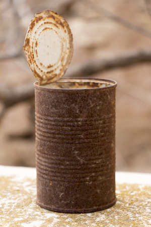 crushed cans: Old rusty crumbled tin can