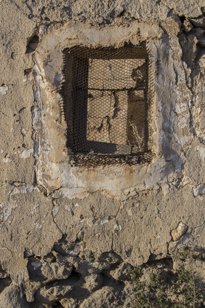 old broken old window, house in ruins, house destroyed by the passage of time Stock Photo