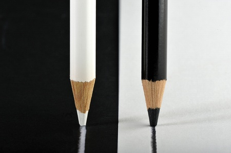 opposite: opposite colored pencils to draw a line in parallel on opposite also funds Stock Photo