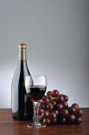 wine still life  with grapes, wineglass and bottle  photo