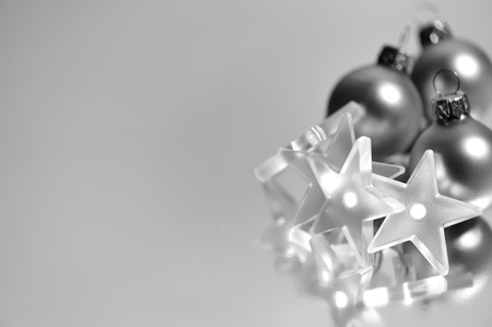 christmas balls with in a star shape lights in black and white photo