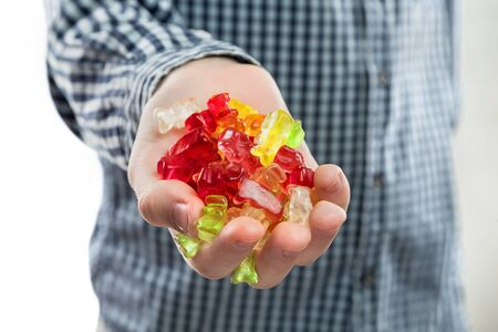 candy bears gelatine placer in the childs hand Stock Photo