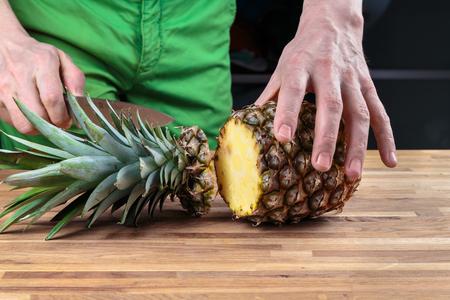 Slicing pineapple on Oak cutting board knife chef