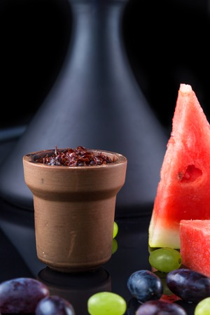 Shisha with Apple flavor in a clay bowl