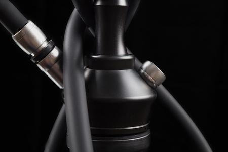 Modern hookah isolated on black background.