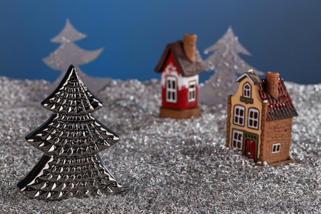 Christmas tree on the background of miniature houses and fabulous new years landscape. Christmas card, new year card. Stock Photo
