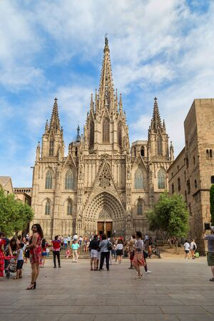 Cathedral of the Holy Cross and Saint Eulalia against a beautiful sky with clouds, Barri Gothic Quarter in Barcelona, Catalonia, Spain 28.06.2018. Frontal view.
