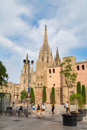Cathedral of the Holy Cross and Saint Eulalia against a beautiful sky with clouds, Barri Gothic Quarter in Barcelona, Catalonia, Spain 28.06.2018. Side view.