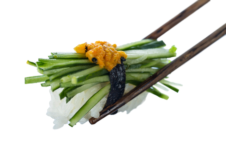 Japanese sushi with cucumber and vegetable caviar on sticks isolated on white background. Healthy diet. Stock Photo
