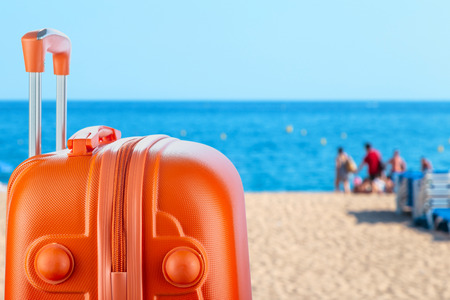 Suitcase bright colors. Concept: rest and travel