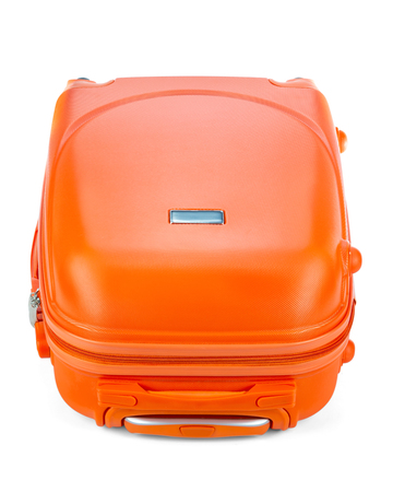 Travel orange suitcase isolated on white background. Stockfoto