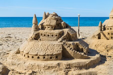 Castle of sand on the beach. Concept: unrealized dreams.
