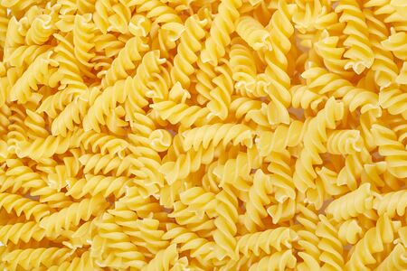 Macaroni or pasta background. Slose up Imagens - 128615684