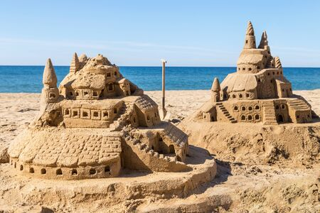 Two different sand castles on the beach. Reklamní fotografie