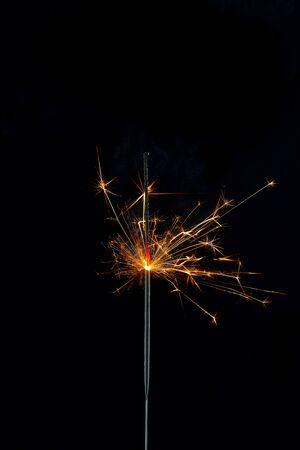 Sparking Bengal fires on black background. Close-up. 写真素材