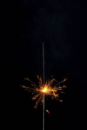 Sparking Bengal fires on black background. Close-up. Imagens - 128615711