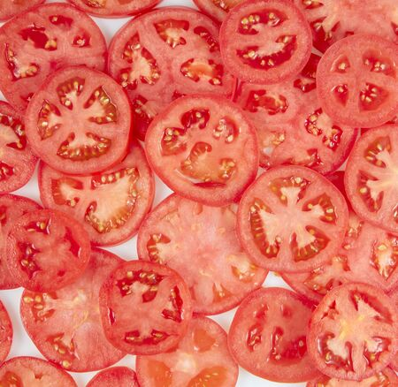 Healthy natural food, background. Tomatoes slices. Square. Imagens