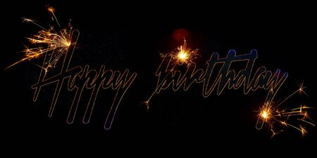 Birthday inscription made of luminous and sparkling Bengali letters on a black background. Isolated image.