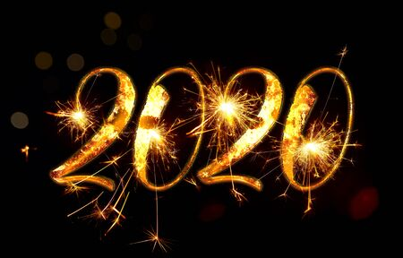 Happy New Year 2020. Number 2020 written sparkling sparklers isolated on black background. Beautiful Glowing overlay template for holiday greeting card. Horizontal. Imagens - 128615848