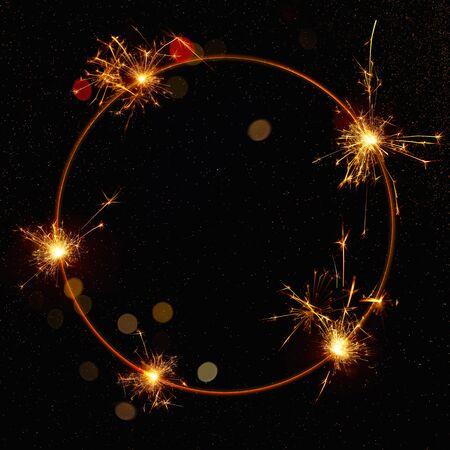 Glowing Sparkler circle on a black background. Mocap for banner.